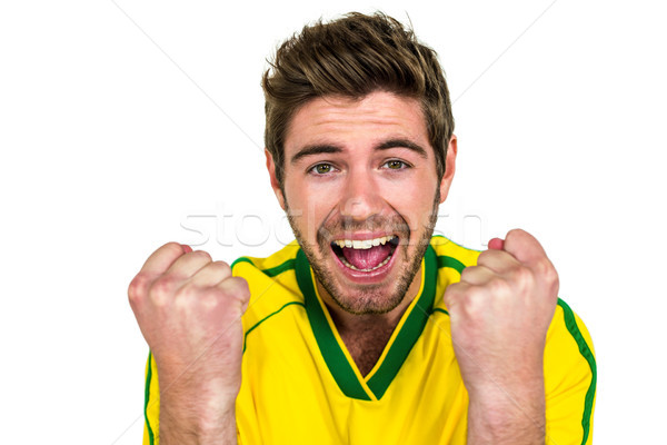 Portré jóképű férfi ujjongás fehér képernyő mosolyog Stock fotó © wavebreak_media