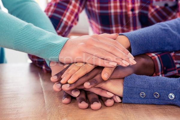 üzletemberek egymásra pakolva kezek asztal kreatív iroda Stock fotó © wavebreak_media