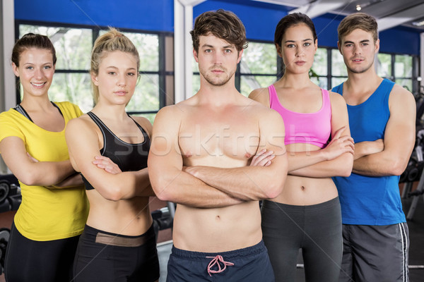 Athletic men and women posing with arms crossed Stock photo © wavebreak_media