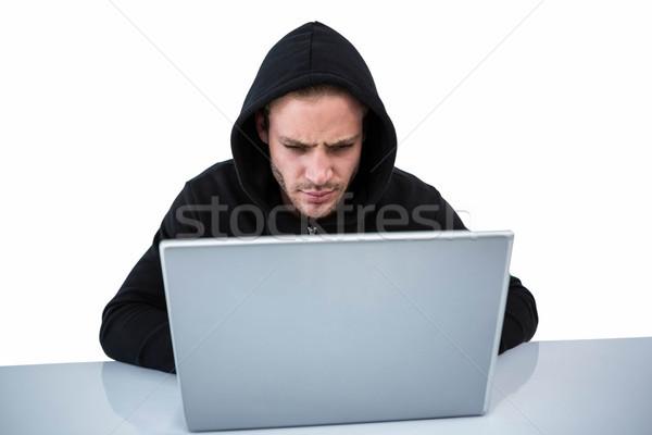 Handsome man in black hoodie using laptop Stock photo © wavebreak_media