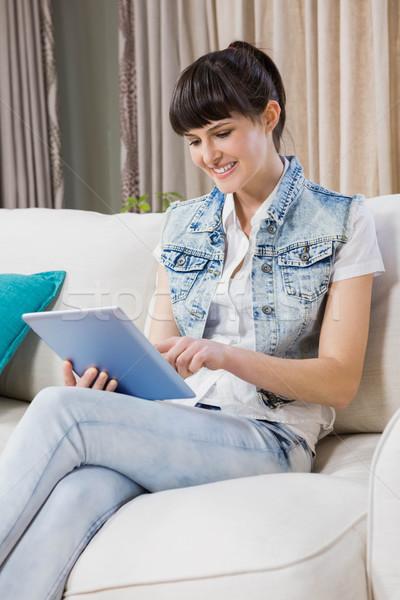 Beautiful young woman using a digital tablet Stock photo © wavebreak_media