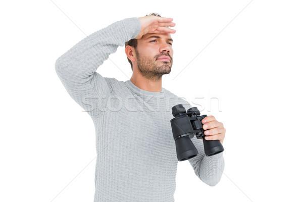 Fiatalember látcső izolált fehér férfi póló Stock fotó © wavebreak_media