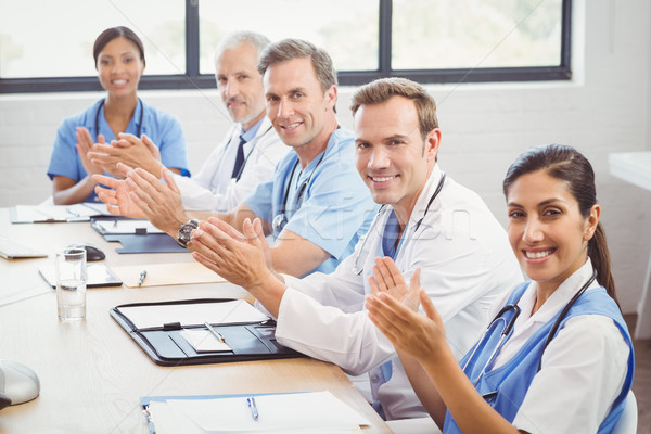 Stock photo: Medical team applauding in conference room