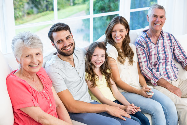 Portrait of smiling family sitting on sofa Stock photo © wavebreak_media