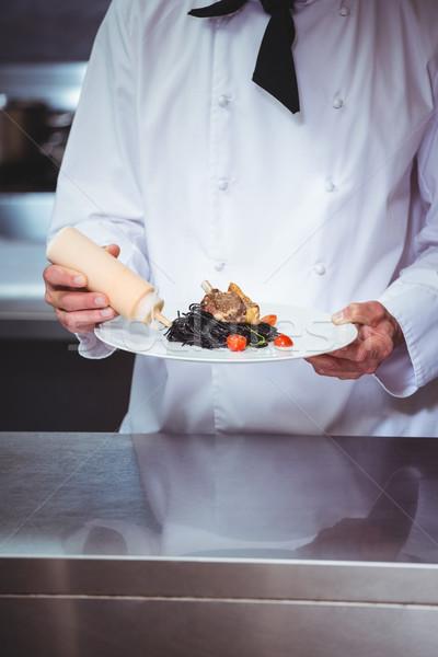 повар соус блюдо спагетти коммерческих кухне Сток-фото © wavebreak_media