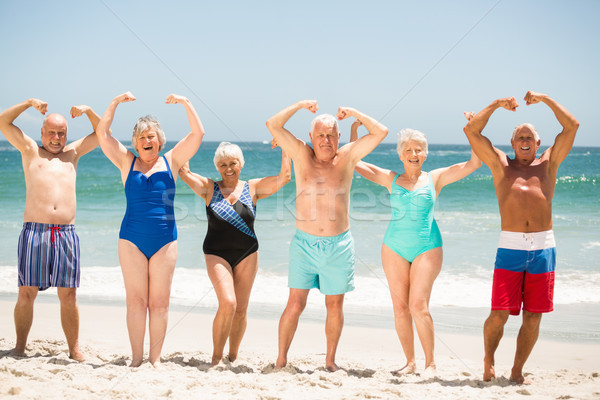 Seniors posing with muscles at the beach Stock photo © wavebreak_media