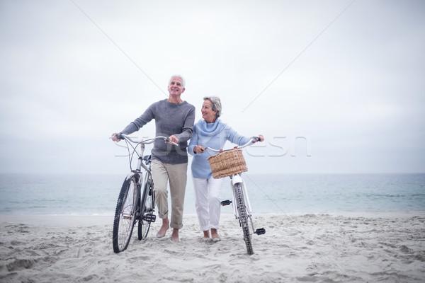 Bike spiaggia donna viaggio piedi Foto d'archivio © wavebreak_media
