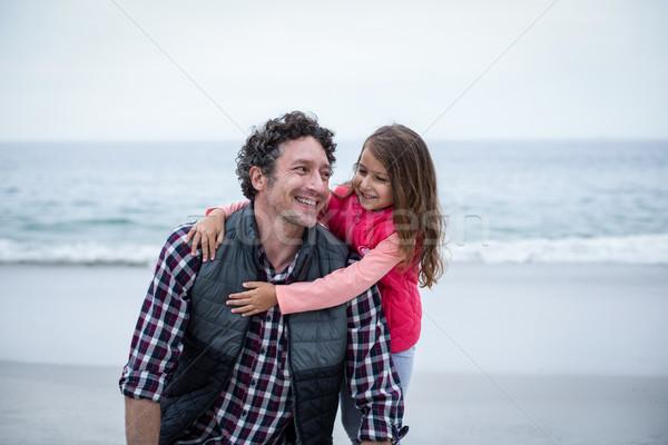 Girl embracing smiling father at beach  Stock photo © wavebreak_media
