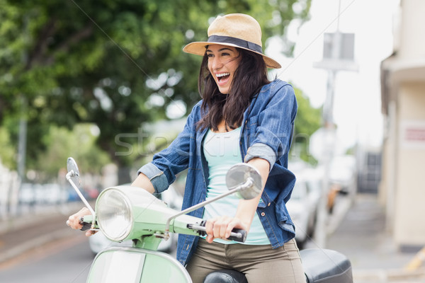 Excited woman riding moped Stock photo © wavebreak_media