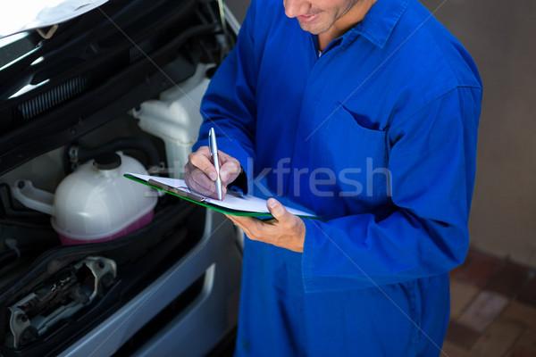 Mechanic preparing a check list Stock photo © wavebreak_media