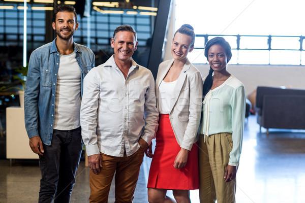 Iş arkadaşları poz birlikte portre ofis Stok fotoğraf © wavebreak_media