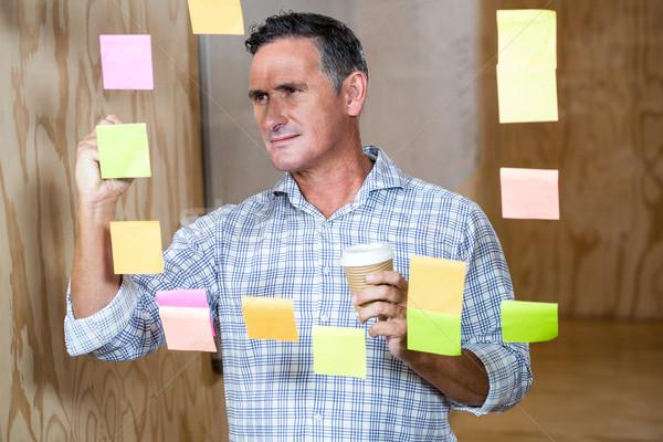 Man writing on sticky notes Stock photo © wavebreak_media