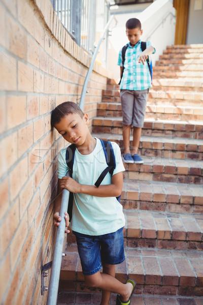 Boy pointing on another boy Stock photo © wavebreak_media
