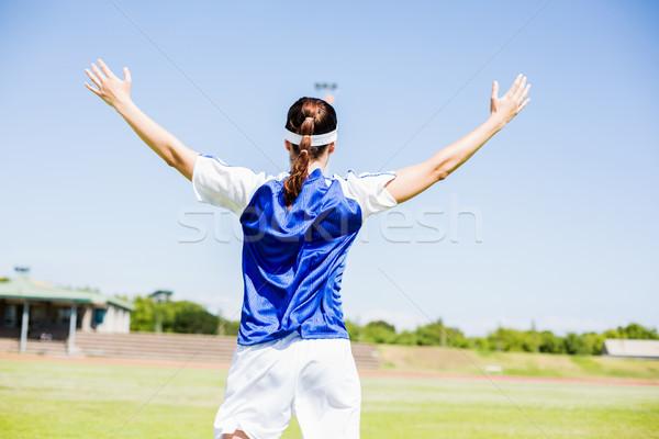 Vue arrière footballeur posant victoire stade femme Photo stock © wavebreak_media