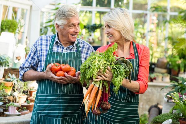 Gardeners with fresh vegetables at greenhouse Stock photo © wavebreak_media