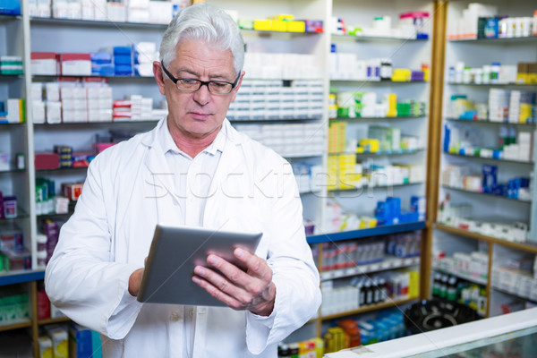 Pharmacist using a digital tablet Stock photo © wavebreak_media