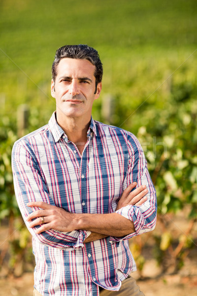 Portrait of male vintner standing with arms crossed Stock photo © wavebreak_media