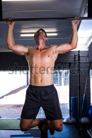 Aggressive shirtless boxer in gym Stock photo © wavebreak_media