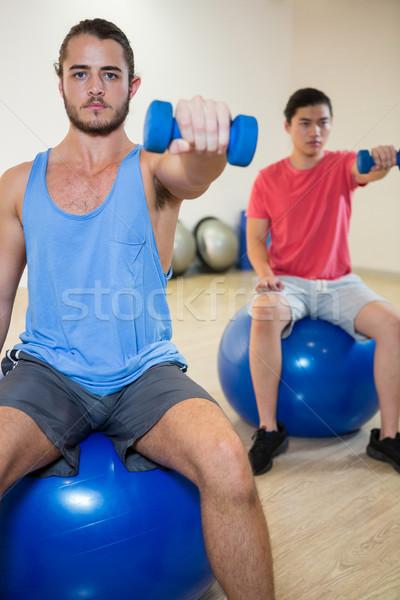 Men exercising on exercise ball Stock photo © wavebreak_media
