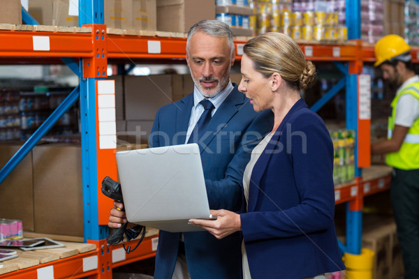 Warehouse manager and client using laptop Stock photo © wavebreak_media