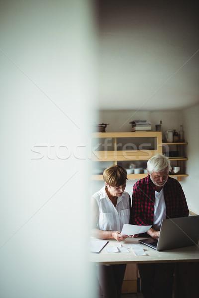 Senior couple paying bills online on laptop Stock photo © wavebreak_media
