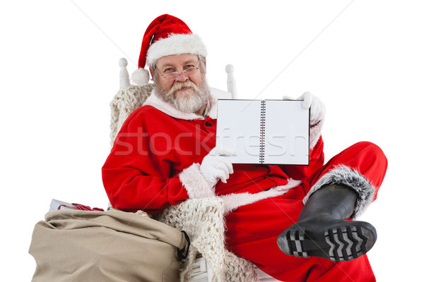 Santa claus holding a diary Stock photo © wavebreak_media