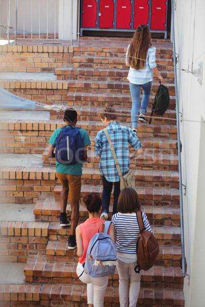 Students moving up staircase Stock photo © wavebreak_media