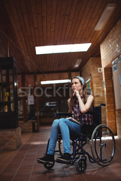 Disabled schoolgirl on wheelchair in corridor at school Stock photo © wavebreak_media
