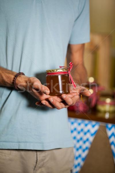 Mid-section of man holding a jar of jam Stock photo © wavebreak_media