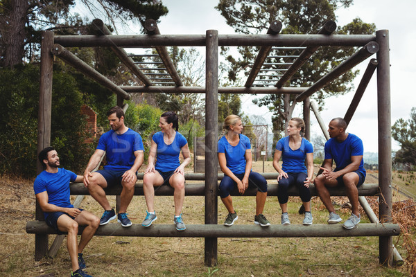 Fit people sitting on the obstacle couse Stock photo © wavebreak_media