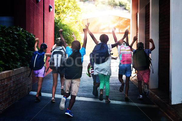 Hátsó nézet játékos osztálytársak fut iskola kampusz Stock fotó © wavebreak_media