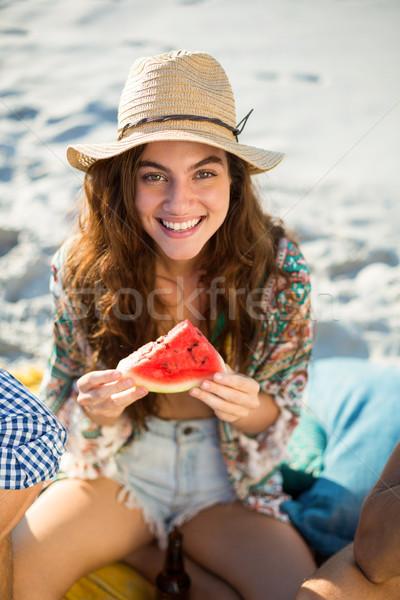 Happy woman having watermelon at beach Stock photo © wavebreak_media