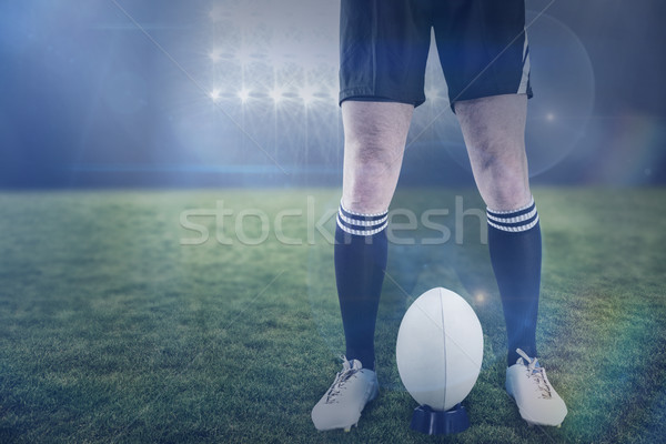 Composite image of rugby player ready to make a drop kick