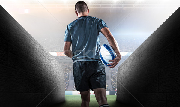 Composite image of rear view of rugby player running with ball Stock photo © wavebreak_media