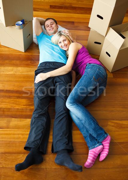 Happy couple relaxing on the floor. Moving house Stock photo © wavebreak_media