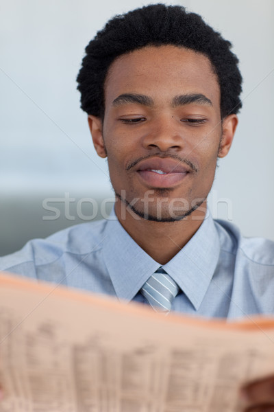 Stock photo: Afro-American businessman reading a newspaper