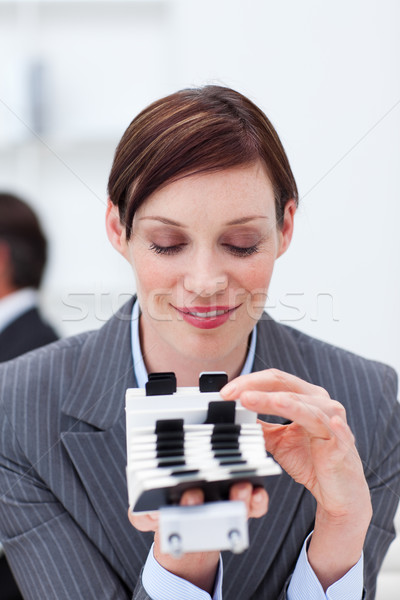 Attractive businesswoman consulting her business card holder Stock photo © wavebreak_media