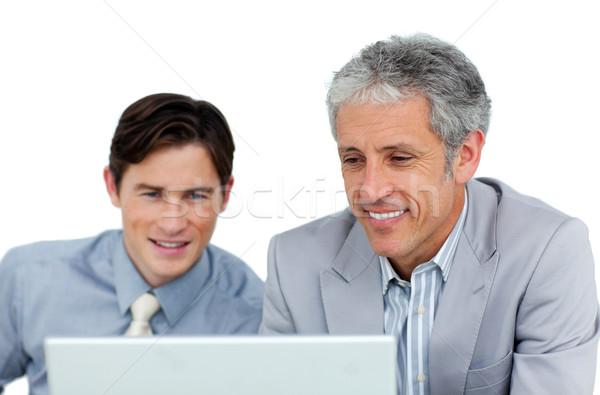 концентрированный бизнесменов рабочих компьютер служба ноутбука Сток-фото © wavebreak_media