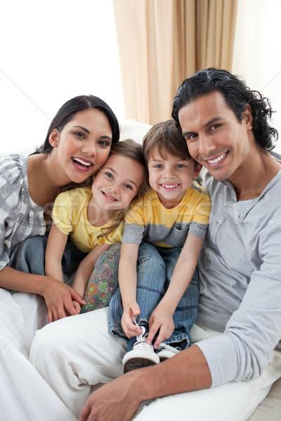 Portrait of an affectionate family sitting on sofa Stock photo © wavebreak_media