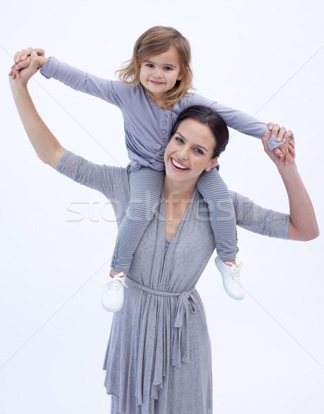 Mother giving her daughter piggyback ride against white Stock photo © wavebreak_media