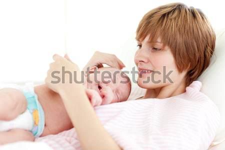 Mother attending to her newborn baby Stock photo © wavebreak_media