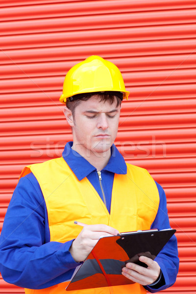 Handsome male engineer writing his report  Stock photo © wavebreak_media