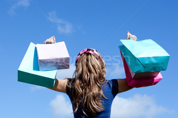 Young woman holding shopping bags outdoor  Stock photo © wavebreak_media