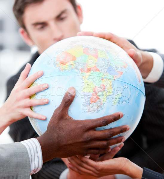 Close-up of a business team holding a terrestrial globe Stock photo © wavebreak_media