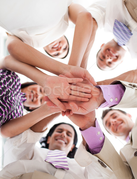 Affaires internationales personnes mains tenant ensemble blanche main Photo stock © wavebreak_media