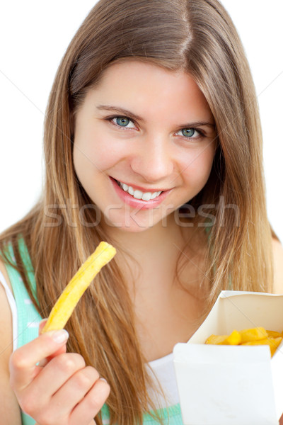 Happy woman holding chips against a white background Stock photo © wavebreak_media