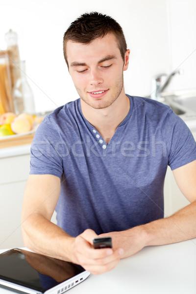 положительный молодым человеком текста Жилье домой Сток-фото © wavebreak_media