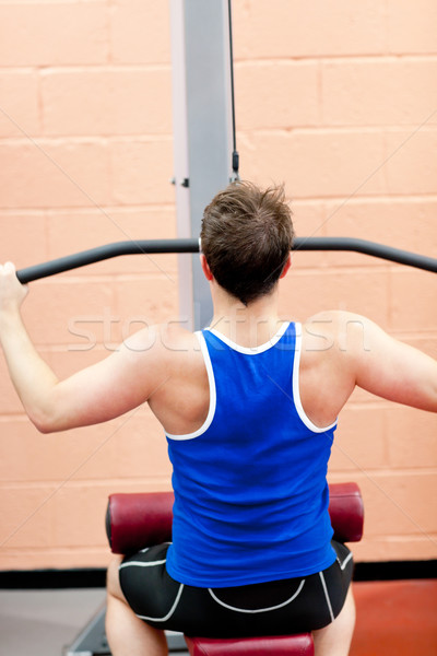 Muscular male athlete practicing body-building in a fitness center Stock photo © wavebreak_media
