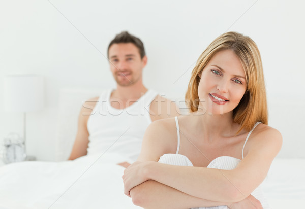 Superb woman looking at the camera with her husband at home Stock photo © wavebreak_media