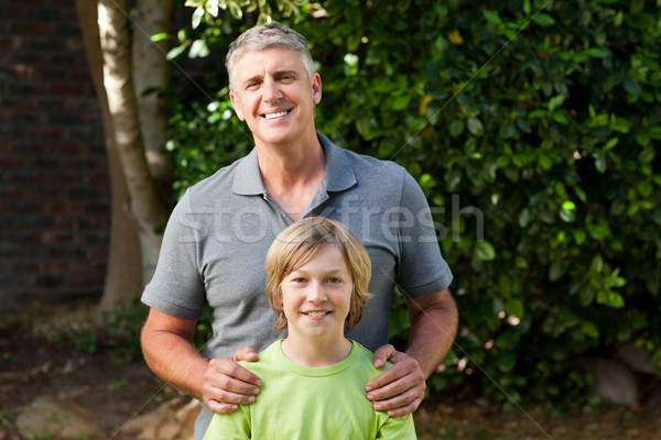 Father and his son looking at the camera in the garden Stock photo © wavebreak_media